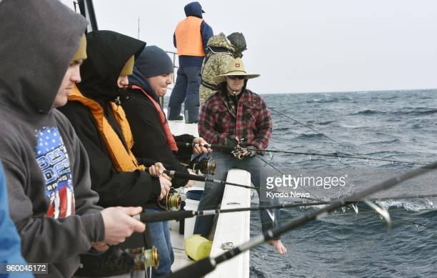 Photo taken Feb 25 shows militaryrelated Americans participating in a fishing tour organized by a former US serviceman in the Seto Inland Sea in...