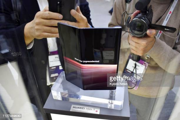 Photo taken Feb 25 shows the new Huawei Mate X foldable smartphone being exhibited at the Mobile World Congress fair in Barcelona ==Kyodo