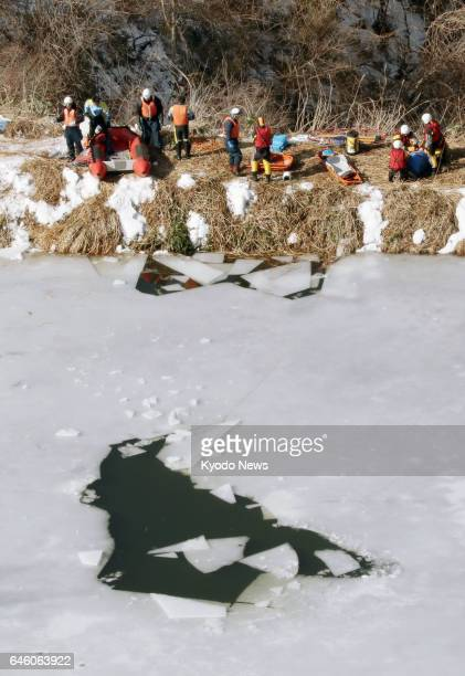 Photo taken Feb 28 from a Kyodo News helicopter shows a crack on an ice covering pond in the northeastern Japan city of Oshu where the bodies of four...