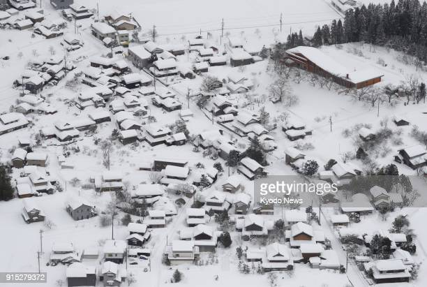 Photo taken Feb 7 2018 from a Kyodo News airplane shows houses and buildings in Echizen Fukui Prefecture covered by heavy snow that hit a wide area...