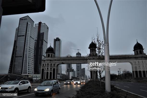 A photo taken from a bus shows new residential apartments and office towers standing behind a welcoming gate in the upperclass neighborhood of...