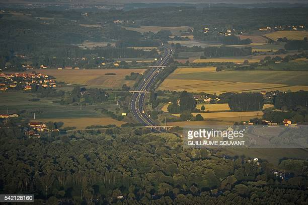 A photo taken from a hot air balloon shows the A10 autoroute near Chatellerault on Junes 22 2016 / AFP / GUILLAUME SOUVANT