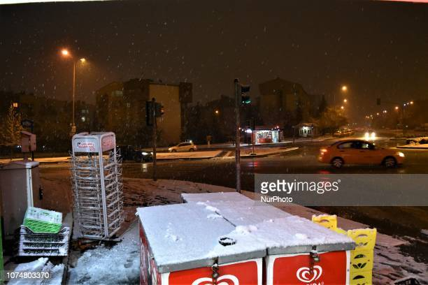 A photo taken from a kiosk shows cars passing through a road intersection during a heavy snowfall in the winter season in Ankara Turkey on December...