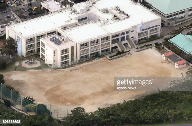 Photo taken from a Kyodo News airplane on Dec 13 shows the Futenma Daini Elementary School in Ginowan in Okinawa Prefecture The school's playground...