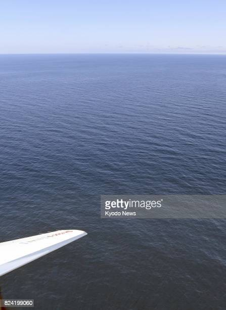 Photo taken from a Kyodo News airplane on July 29 shows an area of the sea where a North Korean intercontinental ballistic missile is believed to...