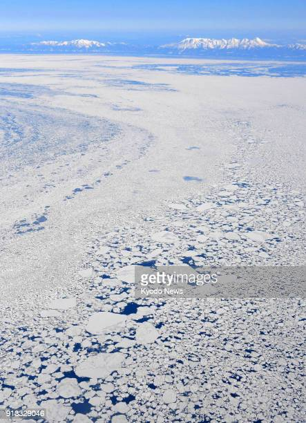 Photo taken from a Kyodo News airplane shows drift ice covering the Sea of Okhotsk off Abashiri on Japan's northernmost main island of Hokkaido on...