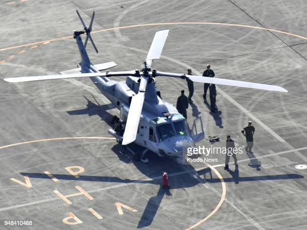 Photo taken from a Kyodo News helicopter on April 18 2018 shows a UH1 helicopter of the US military at Kumamoto airport in southwestern Japan The UH1...