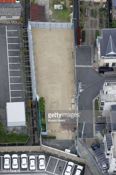 Photo taken from a Kyodo News helicopter on April 28 shows a vacant lot in Kyoto after the completion of work to demolish a Kyoto Animation Co....