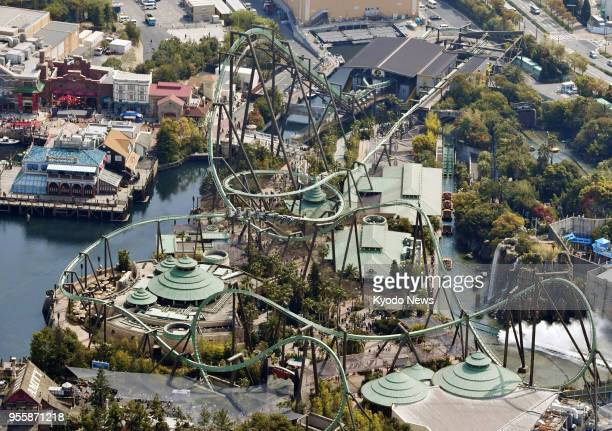 Photo taken from a Kyodo News helicopter on April 4 shows the Flying Dinosaur roller coaster at Universal Studios Japan in Osaka western Japan ==Kyodo