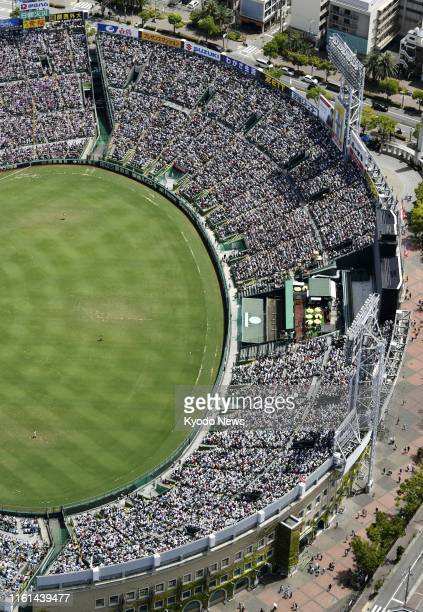 Photo taken from a Kyodo News helicopter on Aug. 13 shows Koshien Stadium in Nishinomiya, western Japan, packed with spectators ahead of a national...