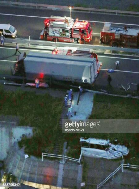 Photo taken from a Kyodo News helicopter on Aug 25 shows a bus that collided with a truck on a highway in the western Japan prefecture of Tokushima...