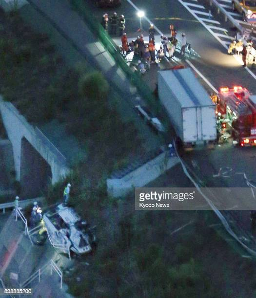 Photo taken from a Kyodo News helicopter on Aug 25 shows a minibus that collided with a truck on a highway in the western Japan prefecture of...