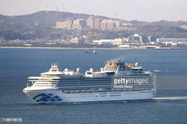 Photo taken from a Kyodo News helicopter on Feb 5 shows the luxury cruise ship Diamond Princess heading for the Pacific Ocean temporarily from...