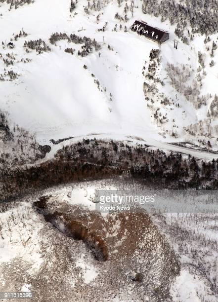 Photo taken from a Kyodo News helicopter on Jan 28 shows a crater of Mt MotoShirane in Kusatsu Gunma Prefecture northeast of Tokyo after its eruption...