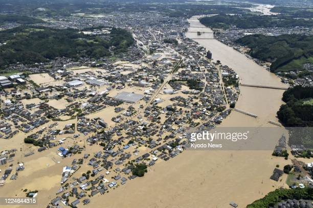 Photo taken from a Kyodo News helicopter on July 4 shows inundated houses in Hitoyoshi in Kumamoto Prefecture, southwestern Japan, after the Kuma...