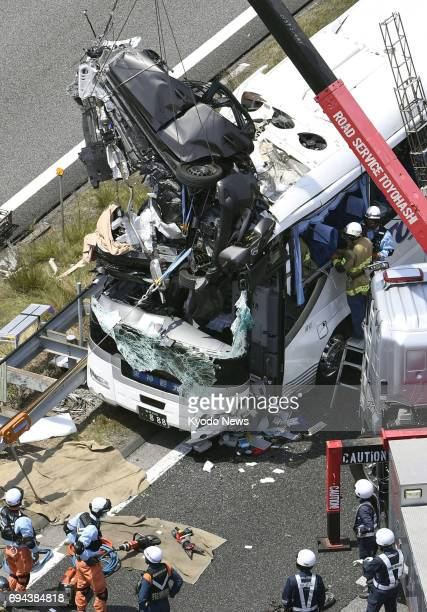 Photo taken from a Kyodo News helicopter on June 10 shows the wreckage of a car after it collided with a tourist bus on an expressway in Shinshiro...