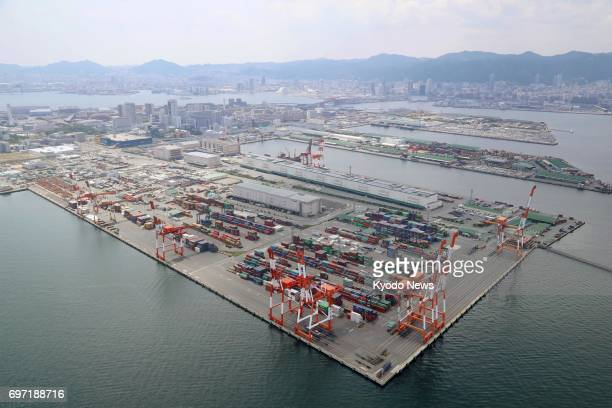 Photo taken from a Kyodo News helicopter on June 18 shows a container yard at Japan's Kobe port where about 100 red fire ants originating in South...
