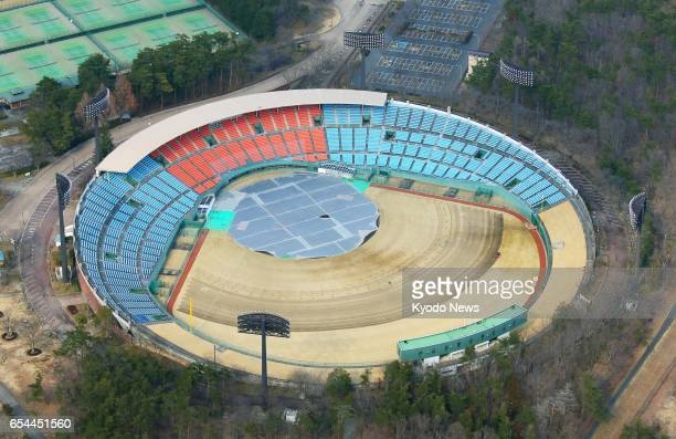 Photo taken from a Kyodo News helicopter on March 17 shows Azuma Stadium in Fukushima the prefectural capital of Fukushima Prefecture Organizers of...