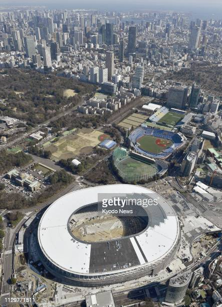 Photo taken from a Kyodo News helicopter on March 9 shows Japan's new National Stadium the main venue for the 2020 Olympics and Paralympics under...