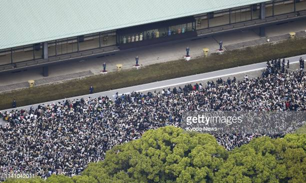 Photo taken from a Kyodo News helicopter on May 4 shows wellwishers who gathered at the Imperial Palace in Tokyo for Emperor Naruhito's first public...