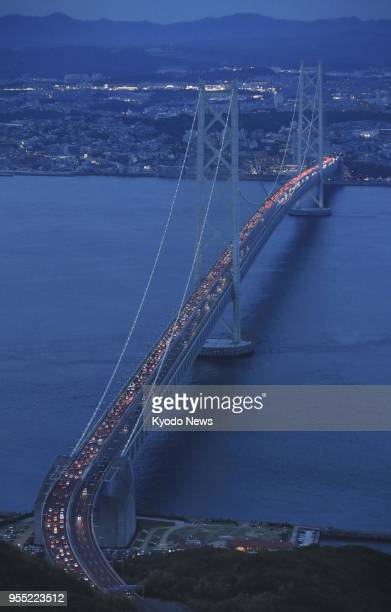 Photo taken from a Kyodo News helicopter on May 5 shows traffic congestion on the Kobebound lane of the Akashi Kaikyo Bridge in western Japan as...