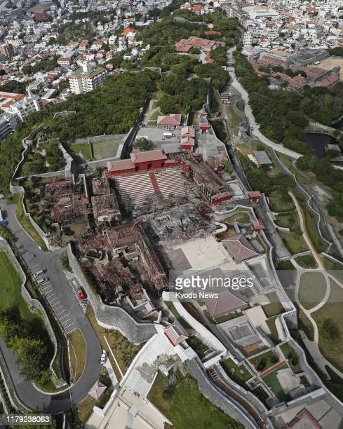 Photo taken from a Kyodo News helicopter on Nov 1 shows Shuri Castle at a World Heritage site in Naha Okinawa Prefecture southern Japan razed by fire...