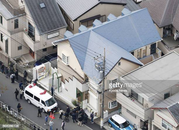 Photo taken from a Kyodo News helicopter on Oct 31 2017 shows an apartment house in Zama Kanagawa Prefecture where police found nine dismembered...
