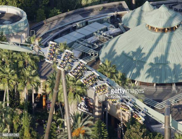 Photo taken from a Kyodo News helicopter on Sept 29 shows the Jurassic Parkinspired Flying Dinosaur roller coaster at Universal Studios Japan in...