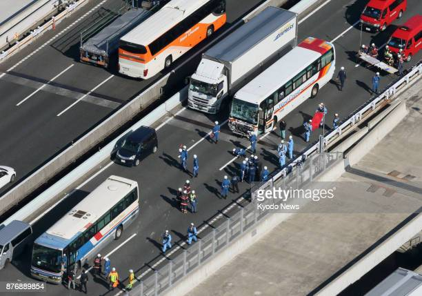 Photo taken from a Kyodo News helicopter shows a bus and a truck damaged in a pileup on an expressway in Ichikawa Chiba Prefecture near Tokyo on Nov...