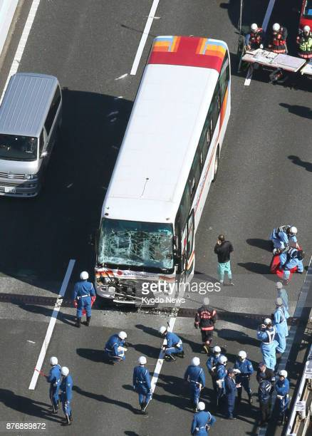 Photo taken from a Kyodo News helicopter shows a bus carrying about 40 junior high school students and teachers damaged in a pileup on an expressway...