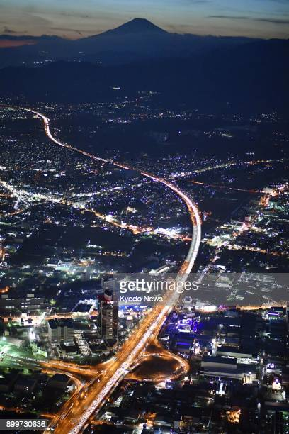 Photo taken from a Kyodo News helicopter shows a congested Tomei Expressway in Kanagawa Prefecture as travelers head for New Year holidays on Dec 30...