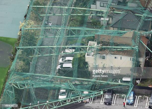 Photo taken from a Kyodo News helicopter shows a golf driving range fence collapsed on top of houses in Ichihara, Chiba Prefecture, on Sept. 9 in the...
