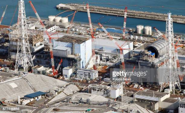 Photo taken from a Kyodo News helicopter shows construction being undertaken at the No 3 reactor of the crippled Fukushima Daiichi nuclear plant in...