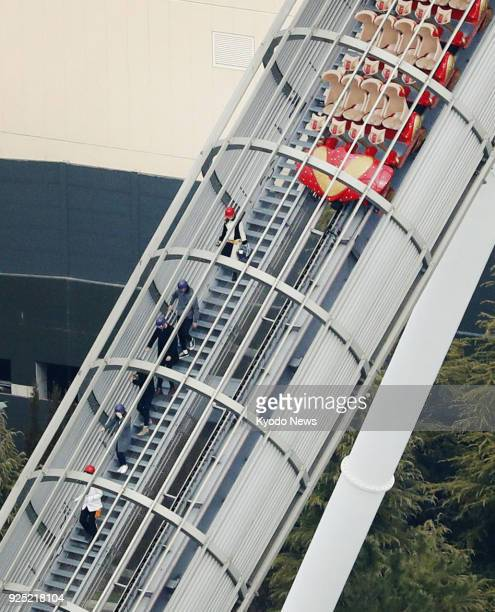 Photo taken from a Kyodo News helicopter shows passengers being guided off the Hollywood Dream The Ride roller coaster at the Universal Studios Japan...