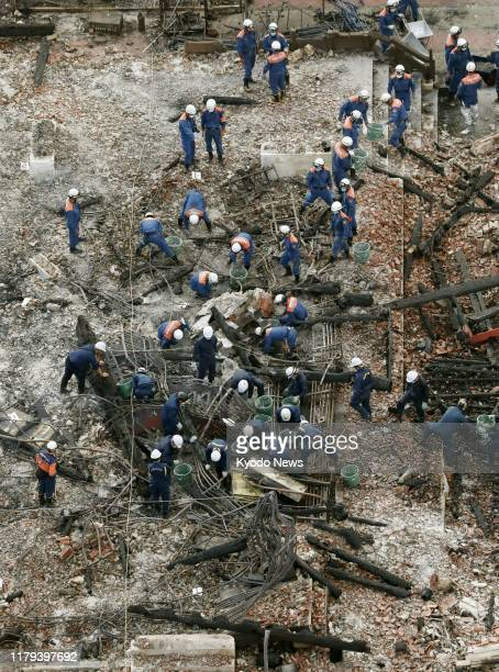 Photo taken from a Kyodo News helicopter shows police officers in Naha Okinawa Prefecture southern Japan on Nov 1 inspecting the area where the...