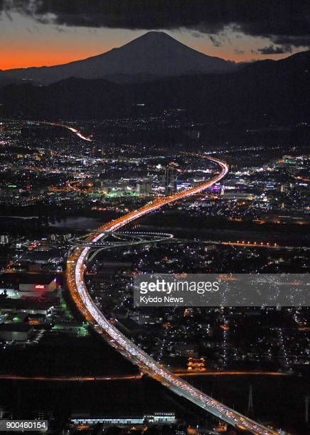 Photo taken from a Kyodo News helicopter shows traffic congestion on the Tomei Expressway in Kanagawa Prefecture as travelers return home at the end...