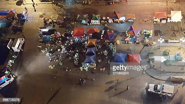 A photo taken from a mobile phone shows a general view of the site of an explosion at a night market in Davao City in southern island of Mindanao on...