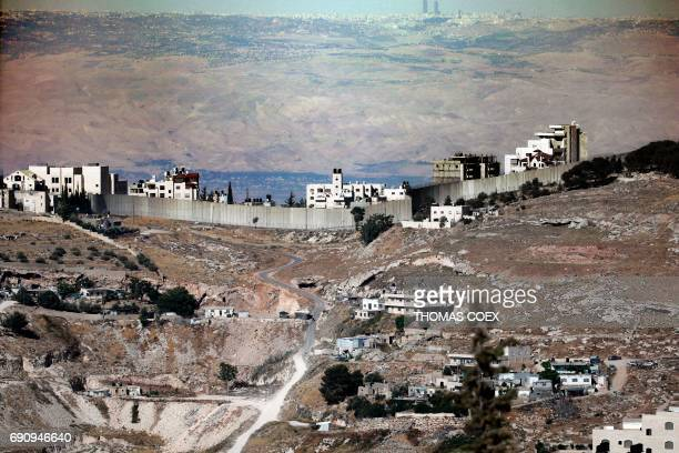 A photo taken from East Jerusalem on May 31 2017 shows a view of Israel's controversial separation barrier dividing Jerusalem from the West Bank city...