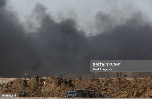 """Photo taken from Nahal Oz area of Israel, shows Israeli soldiers during Palestinians' demonstration, organized within the """"Great March of Return""""..."""