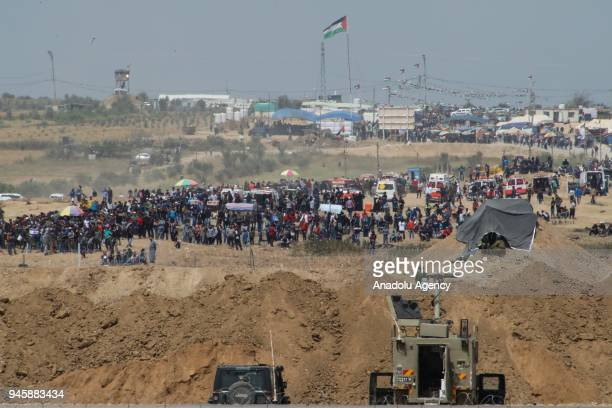 """Photo taken from Nahal Oz area of Israel, shows Palestinian protesters during a demonstration, organized within the """"Great March of Return"""" despite..."""