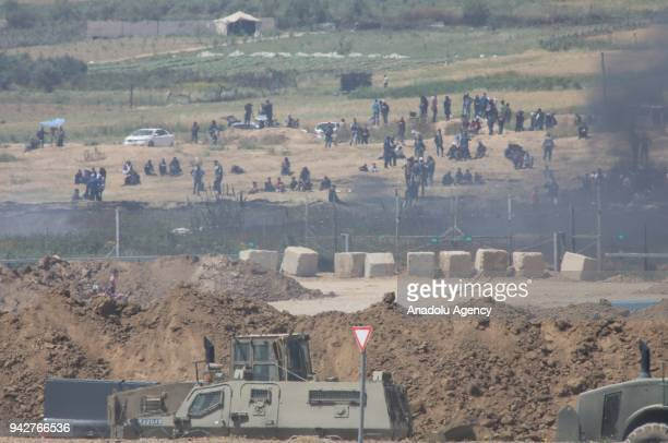 A photo taken from Nahal Oz area of Israel shows Palestinian protestors during a demonstration organized within the 'Great March of Return' despite...