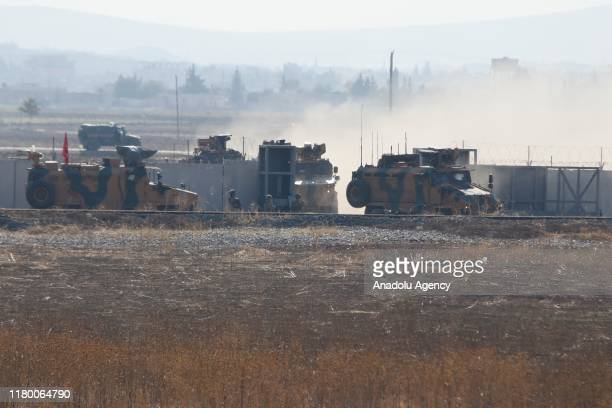 Photo taken from Sanliurfa province of Turkey shows Turkish and Russian troops after completing the second joint ground patrols in the east of...