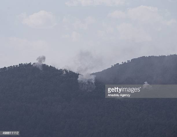 Photo taken from the Hatay province of Turkey shows that smoke rises as the Russia and Syrian regime forces attack the Turkmen region near Turkeys...