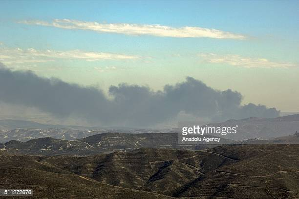 Photo taken from the Hatay province of Turkey shows that smoke rises as Russian and Syrian war crafts carried out airstrikes at opposition conrolled...