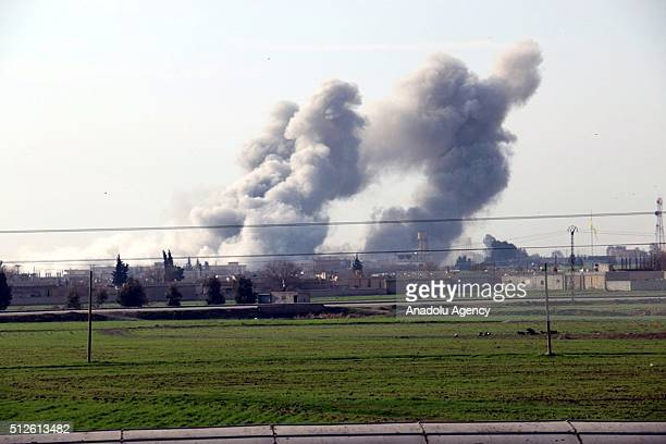 Photo taken from the Sanliurfa province of Turkey shows that smoke rises as unidentified war crafts carried out airstrikes at Daesh conrolled Tell...