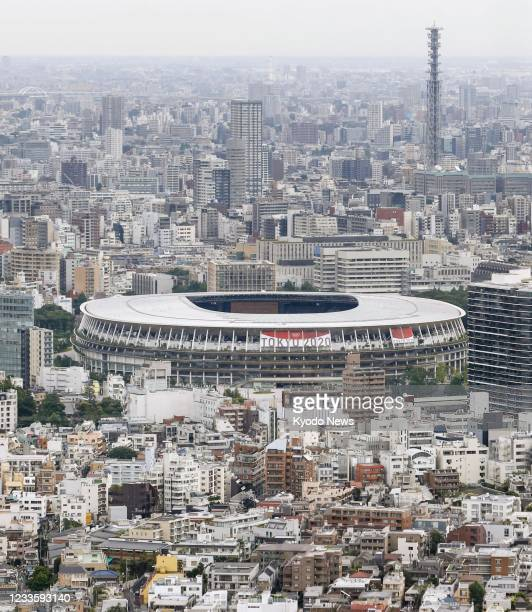 Photo taken from the Shibuya Sky observation deck in Tokyo on June 22 shows the National Stadium, the main venue of the Tokyo Olympics and...