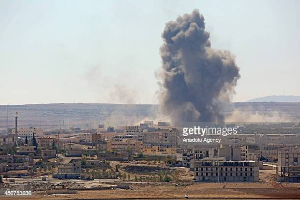 A photo taken from the Suruc district of Sanliurfa Turkey shows smoke rises from Ayn alArab city of Syria after the USled coalition bombed the...