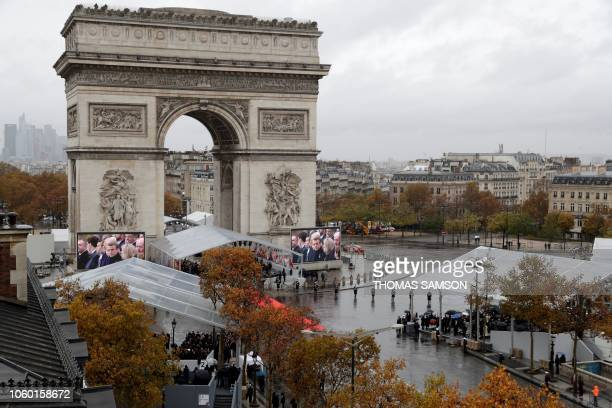 Photo taken from the terrasse of the Drugstore Publicis shows world leaders attending a ceremony at the Arc de Triomphe in Paris on November 11 as...