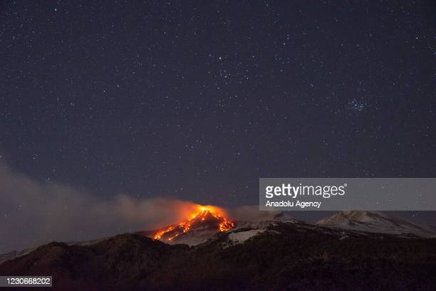 Photo taken from the village of Milo near Catania shows eruption from at Mount Etna, characterized by a strombolian activity on the top of the...