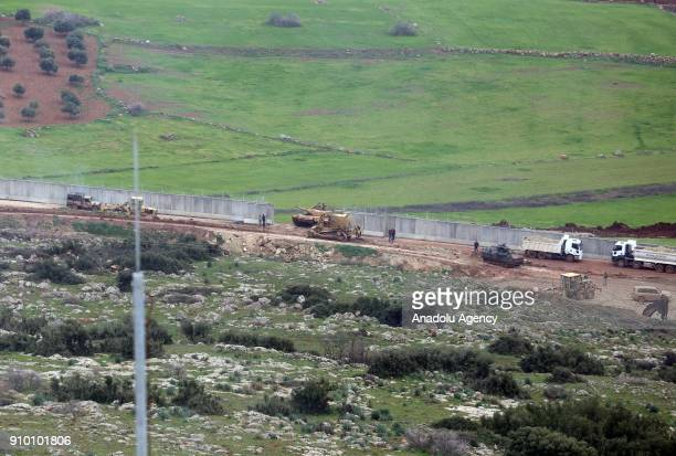A photo taken from Turkey's Hatay border shows Turkish military forces' vehicles within the 'Operation Olive Branch' in Afrin against PKK/PYD...